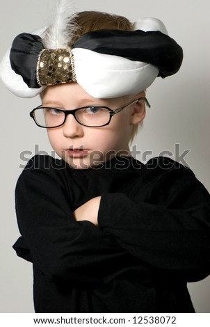 Portrait of the small magician in glasses.Carnival - stock photo