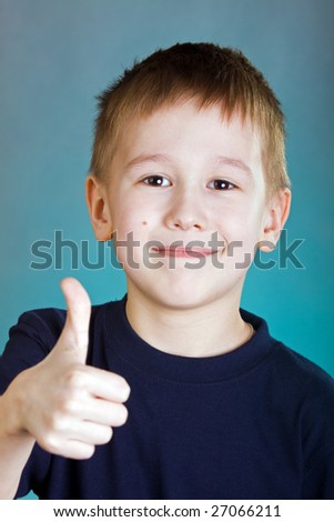 Portrait of the smiling boy isolated on a white background - stock photo