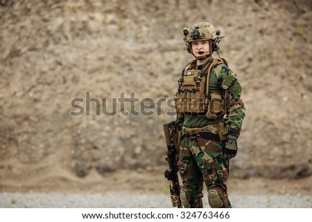 portrait of the special forces soldier on battlefield - stock photo
