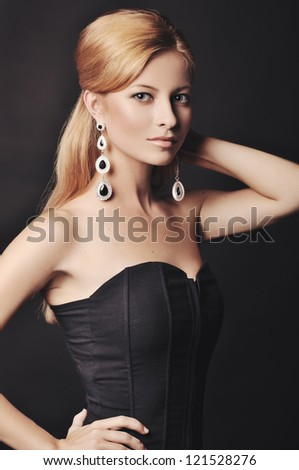 portrait of the stylish woman with beautiful hair and luxury jewelry - stock photo