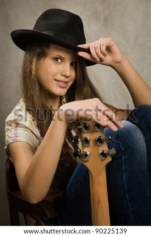 Portrait of the teenager girl with electric guitar - stock photo
