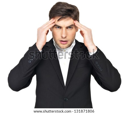 Portrait of the thinking businessman   with hands at head at studio. Portrait of a young man who is under heavy stress