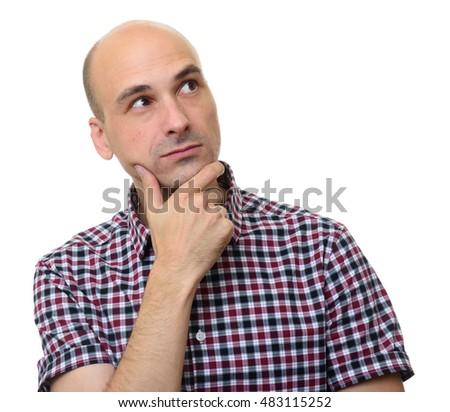 Portrait of the thinking man looks up with hand on chin. Isolated on white.