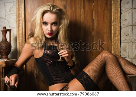 Portrait of the very pretty woman vamp - stock photo