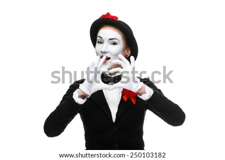 Portrait of the woman as mime with hands folded in the shape of a heart isolated on white background. Concept of love - stock photo