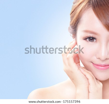 portrait of the woman with beauty face and perfect skin isolated on blue background, asian beauty - stock photo