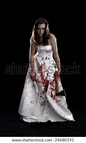 portrait of the woman with knife and axe on black background - stock photo