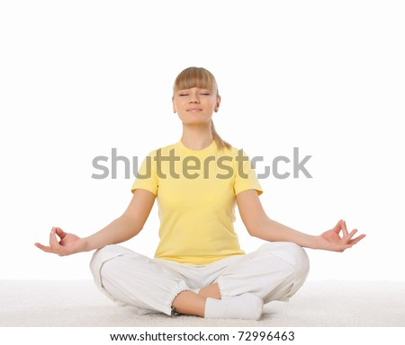 Portrait of the young attractive woman doing yoga exercises - stock photo