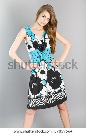 Portrait of the young beautiful girl in elegant clothes - stock photo