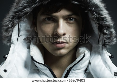 Portrait of the young beautiful man in a white jacke - stock photo