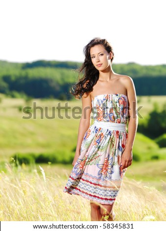 Portrait of the young beautiful  woman outdoors - stock photo
