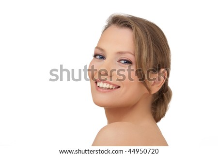 Portrait of the young European smiling woman, on white background - stock photo