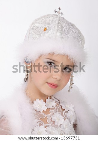 Portrait of the young girl in a fantastic winter suit on a white background - stock photo