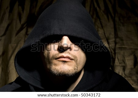 Portrait of the young man in hood