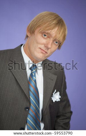 Portrait of the young man - the groom on violet background - stock photo