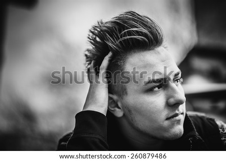 Portrait of the young men outdoor - stock photo