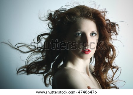 Portrait of the young sexy girl with wavy hair - stock photo