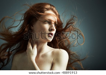 Portrait of the young sexy girl with wavy hair
