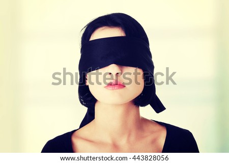 Portrait of the young woman blindfold - stock photo
