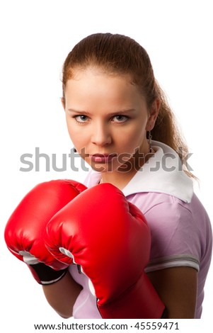 portrait of the young woman in boxing gloves on white background