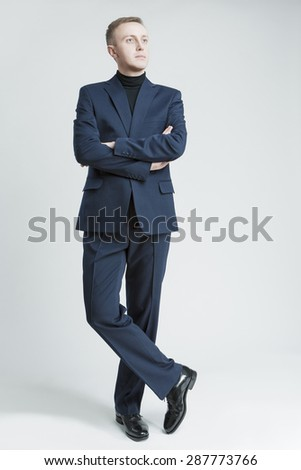 Portrait of Thinking Stylish Caucasian Man in Made to Order Suit. Posing Against White Background. Vertical Image - stock photo