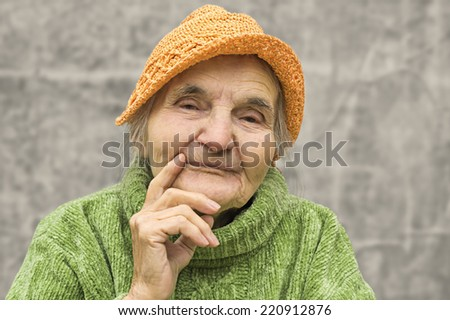 Portrait of thoughtful elderly woman - stock photo