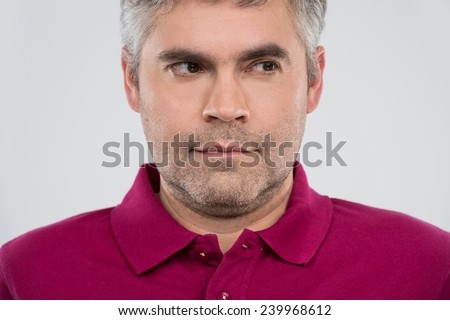 Portrait of thoughtful man with close up view. Portrait of thoughtful adult man on white background  - stock photo