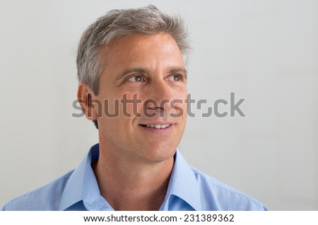 Portrait Of Thoughtful Mature Man Thinking About His Future - stock photo