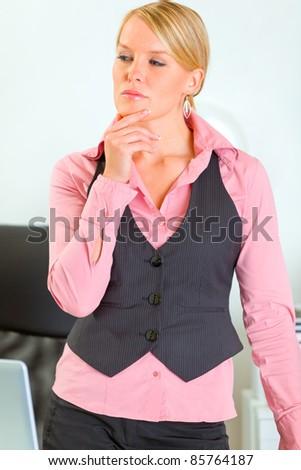 Portrait of thoughtful modern business woman - stock photo