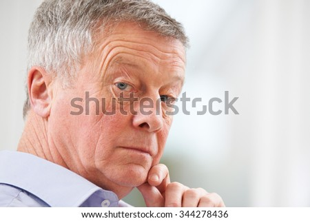 Portrait Of Thoughtful Senior Man At Home