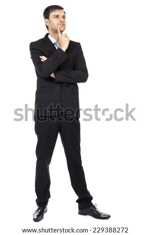 Portrait of  thoughtful young business man with arms folded isolated over white background - stock photo