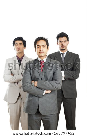Portrait of three businessmen standing with their arms crossed
