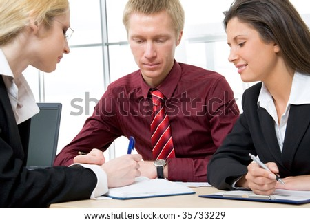 Portrait of three businesspeople discussing new project - stock photo