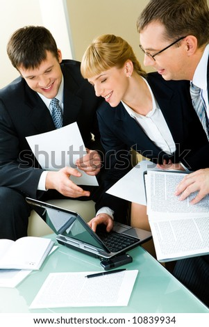 Portrait of three confident business people working together