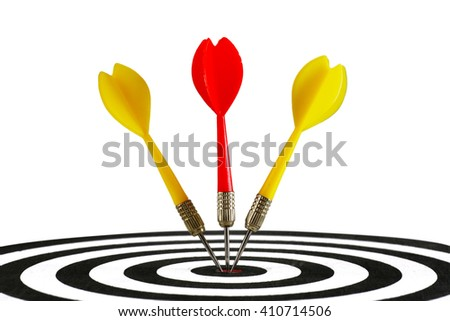 Portrait of three darts hitting the middle of dartboard, isolated on white background - stock photo