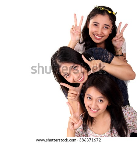 Portrait of three female friends looking at camera with funny expression, isolated on white background for copy space - stock photo