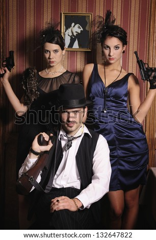 Portrait of three gangsters with guns, retro style. - stock photo