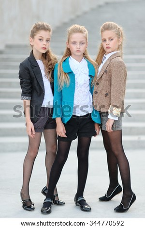 Portrait of three girlfriends on the nature - stock photo