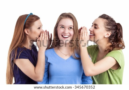 Portrait of Three Happy Caucasian Females Sharing Secrets and Rumoring To each Other To Ears. Isolated On White Background - stock photo