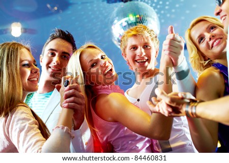 Portrait of three happy couples dancing at party - stock photo