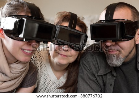 portrait of three persons with virtual reality glasses