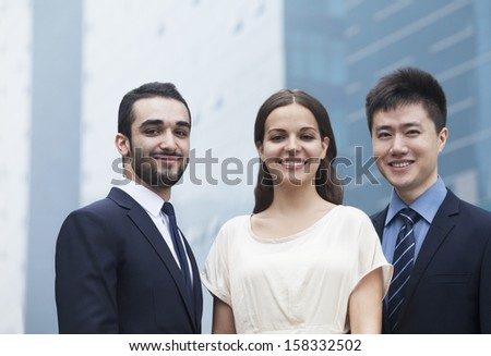 Portrait of three smiling business people - stock photo