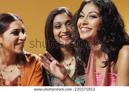 Portrait of three women smiling - stock photo