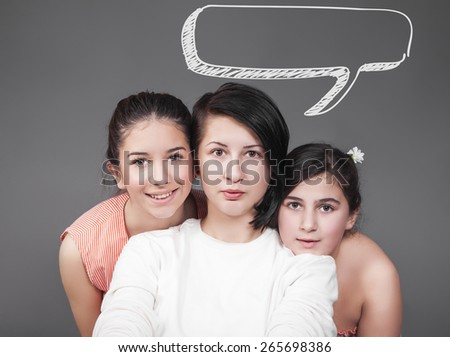 Portrait of three young girls with speech bubble - stock photo
