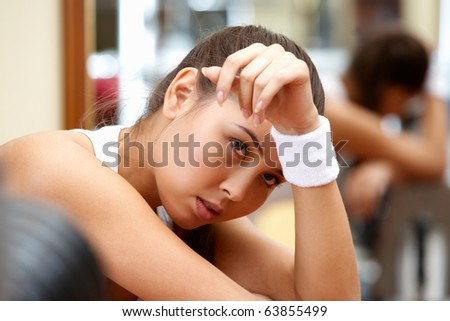 Portrait of tired brunette having rest in short break after workout - stock photo