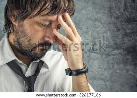 Portrait of tired exhausted businessman in trouble, problems in career, in company or on workplace - stock photo