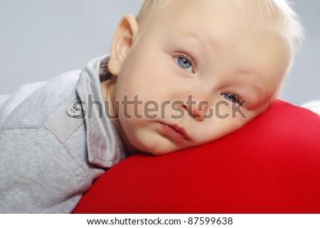 Portrait of tired little boy - stock photo