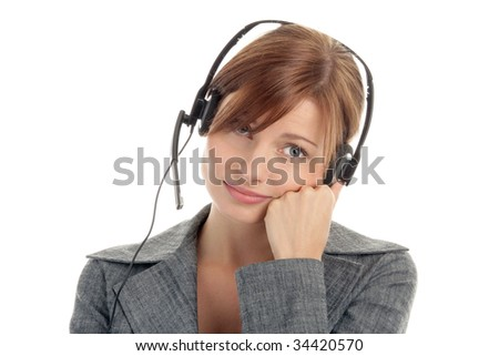 Portrait of tired secretary/telephone operator wearing headset isolated over white background