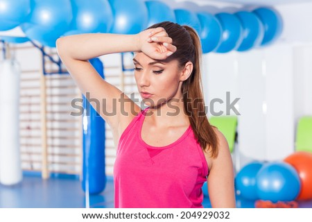 Portrait of tired woman having rest in short break after workout - stock photo