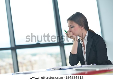 Portrait of tired young business woman at the office - stock photo
